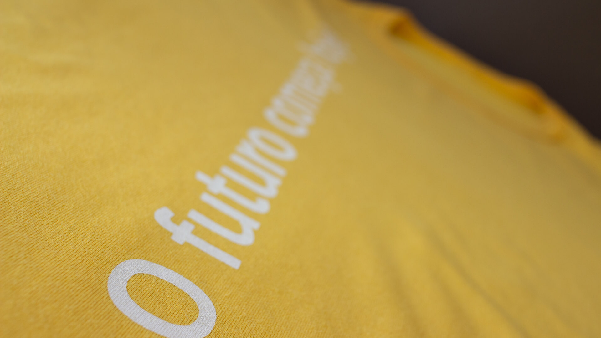 """""""The future starts today"""" on the vertically on the front of the t-shirt."""