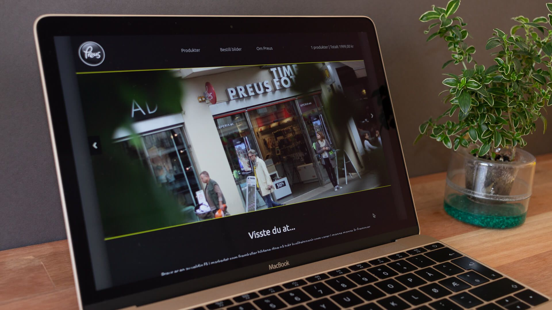 Home page header with slide show for campaigns and image of one of the store fronts.